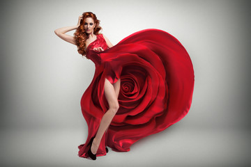 Beautiful young woman wearing red rose dress.