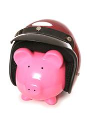 piggy bank wearing a crash helmet
