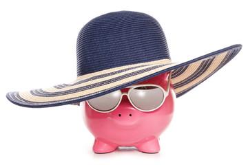 piggy bank wearing a summer hat
