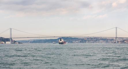 Bosphorus with buildings and suspension bridge in Istanbul