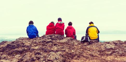 Family enjoying view of Edinburgh from top of Arthurs seat