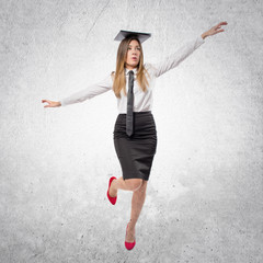 young businesswoman in equilibrium over white background