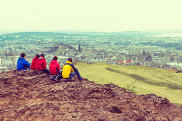 Family enjoying view of Edinburgh from top of Arthurs seat