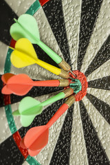 Darts in the center of the target