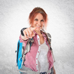 backpacker pointing to the front over white background