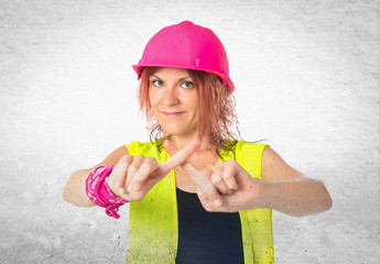 Worker woman doing NO gesture over white background