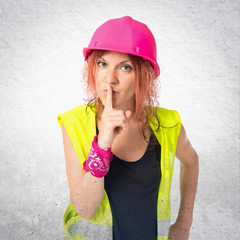 Worker woman making silence gesture over isolated white backgrou