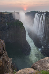 Victoria Falls sunset from Zambia side, rocks in the foreground