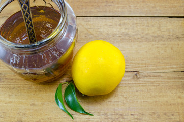 Whole lemon and honey in a jar