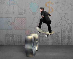 Businessman skating on money skateboard across metal dollar sign
