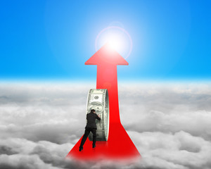 Businessman pushing money circle on red arrow with sunlight clou