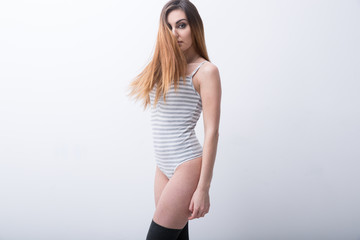 Sexy beautiful woman standing over gray background