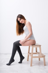Cheerful sexy woman sitting on the chair