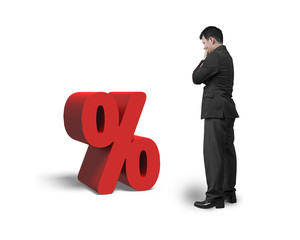 Thinking salesman looking at red percentage sign isolated on whi