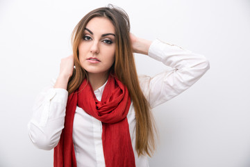 portrait of attractive young woman over gray background