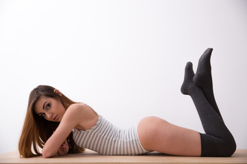 Sexy attractive young woman lying on the table