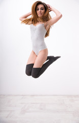 Portrait of a beautiful fit woman jumping