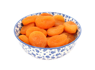 Dried apricots in a blue and white china bowl
