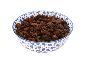 Raisins in a blue and white china bowl