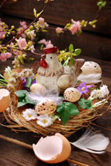 easter decoration with hen in the nest and eggs