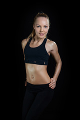 Athletic young woman showing trained beautiful body