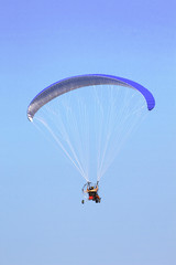 Paramotor in the blue sky