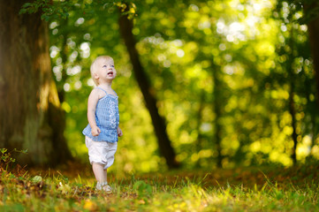 Cute toddler girl outdoors on summer