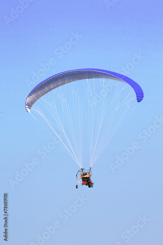 Paramotor in the blue sky - 78689118