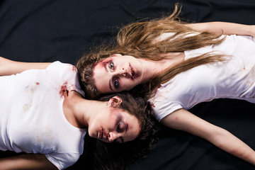 Two young women after domestic violence