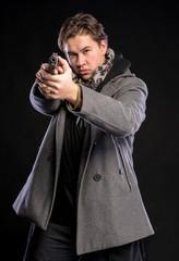 Handsome man with a gun