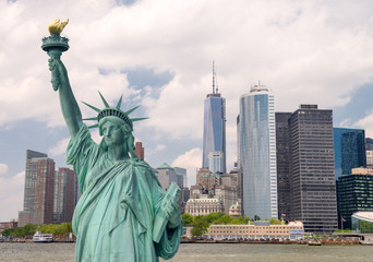 New York City tourism concept. Statue of Liberty with Lower Manh