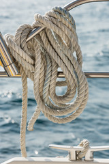 A rope tied around a rail on a yacht