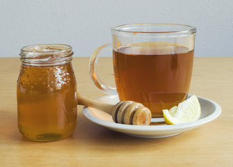 Cup of tea with honey and lemon