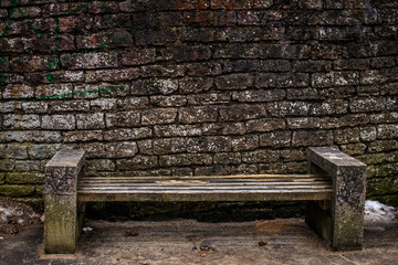 Bench isolated on grey stones background.