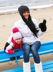 Mother and doughter on a beach