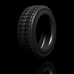 Black tire isolated on black background