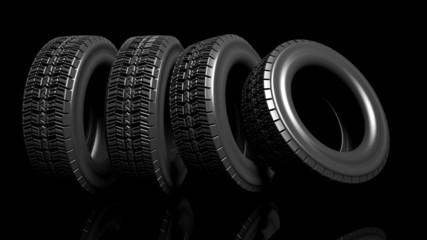 Group of black tires isolated on black background