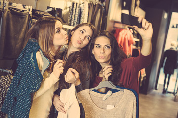 Three women taking a selfie while shopping