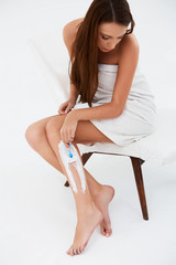Long Woman Legs . Beautiful Woman Shaving legs isolated on white