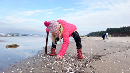 Looking for sea shells on a cold day.