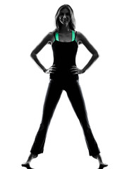 woman dancer  stretching warming up exercises silhouette