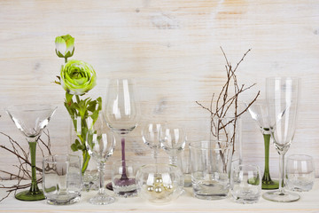 Collection of various glassware on wooden background