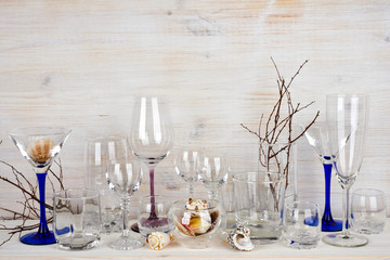 Still life of various glassware on wooden background