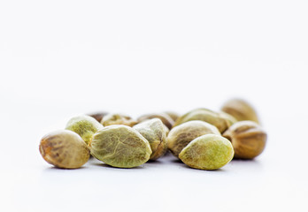 Close view of hemp seeds in a white background