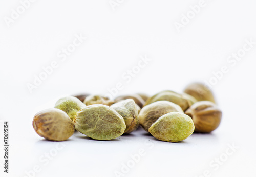 Fotobehang Granen Close view of hemp seeds in a white background