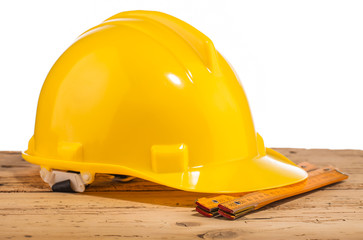 yellow helmet   and measure tool