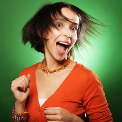 young expression woman over green background