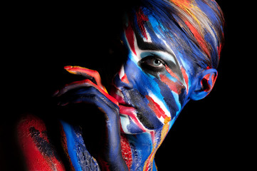 girl in a bright colored paint body art
