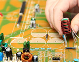 PCB mounting by human hands. In manual soldering TECHNOLOGIES th