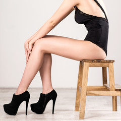 Closeup portrait of a woman sitting on the wooden chair